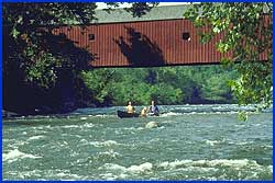 Canoeing Beneath the Covered Bridge
