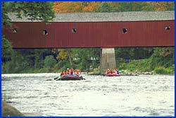 Rafting unde the covered bridge.